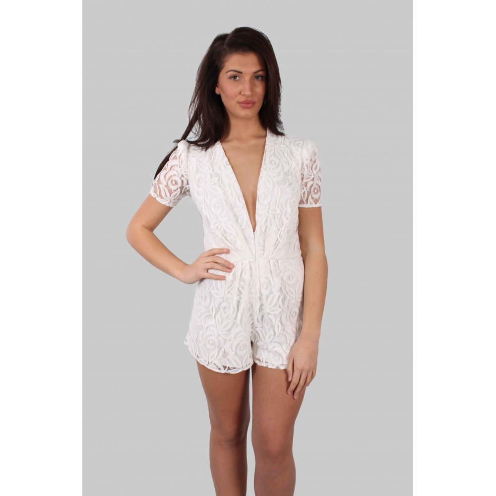 What's not to love about the Orbit chiffon playsuit, featuring a monochromatic all white polka dot textured design and removable sash belt for a more accentuated waistline.
