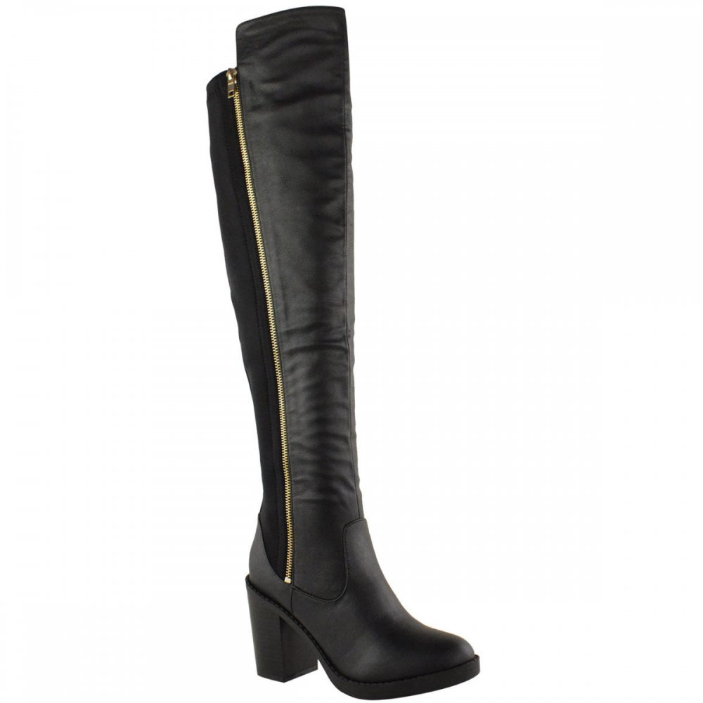 black leather elasticated low heel boots gold zip detail