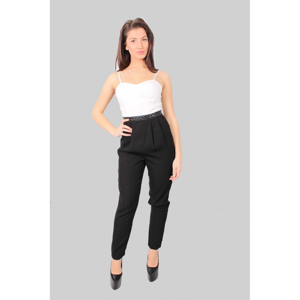 Sleeveless jumpsuit in woven viscose fabric. Opening at back of neck with snap fastener, elasticized seam at waist, side pockets, and short legs.