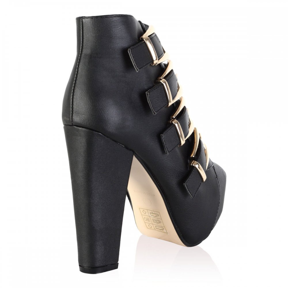 black block heel ankle boots with gold buckles