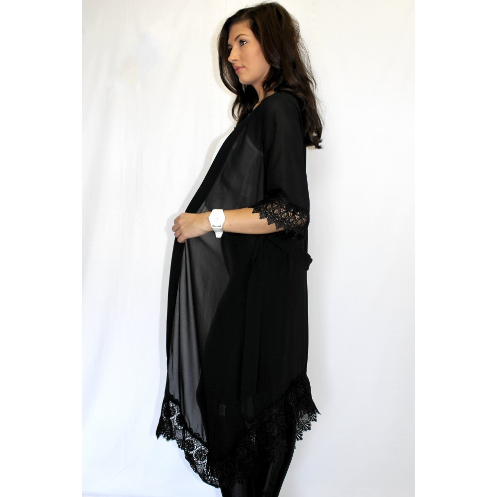 Want to show off but don't feel like bearing it all? This kimono has got your back! It has an open front with a drawstring waist, and flowy kimono sleeves with an overall relaxed fit. Garment is composed of a lightweight sheer chiffon fabric with no stretch. Model is 5'7 with a 34