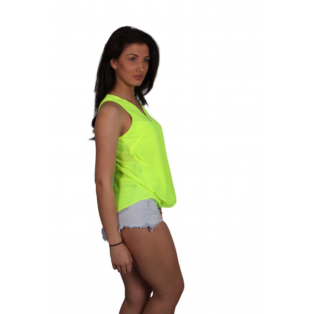 Neon blue fishnet camisole top with neon green trim, halter ties, matching thong and thigh warmers.